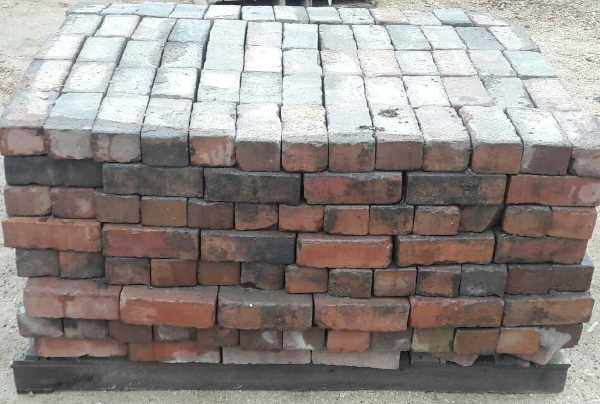 reclaimed street pavers on a pallet
